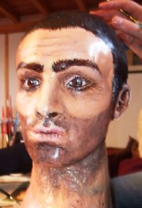 Completed head of male tango puppet