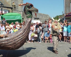 Viking longship made of willow and paper, worn by 12 people in a parade