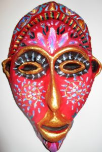 Highly decorated theatrical mask