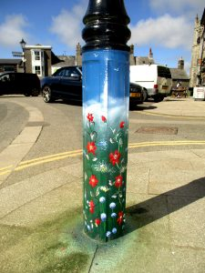decorated painted lamp post mural flowers vines